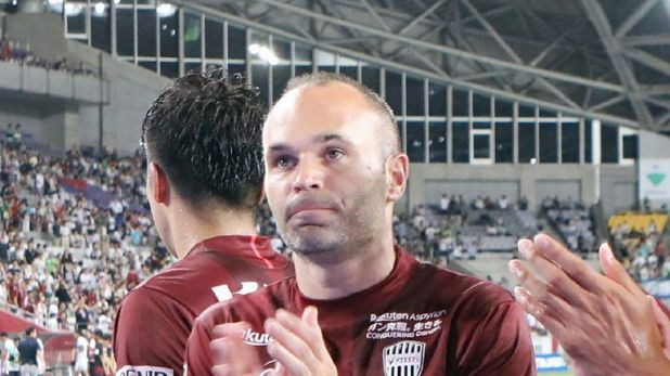 Iniesta applauds the fans after his side's defeat