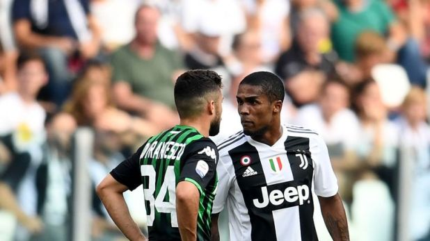Douglas Costa was sent off for spitting at an opponent on Sunday