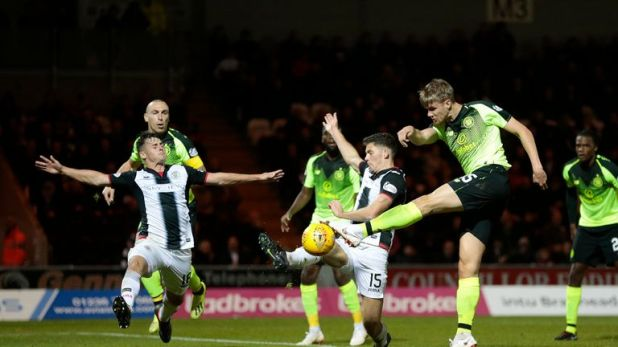 Celtic's Kristoffer Ajer (right) shoots at goal
