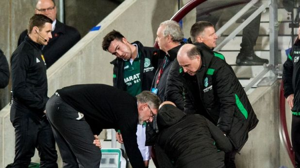 Hearts manager Craig Levein consoles Hibernian manager Neil Lennon after appearing to be struct by an object from the crowd