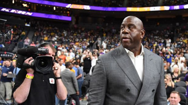 Los Angeles Lakers president of basketball operations Earvin 'Magic' Johnson arrives at the Lakers' preseason game against the Golden State Warriors at T-Mobile Arena on October 10, 2018 in Las Vegas, Nevada.
