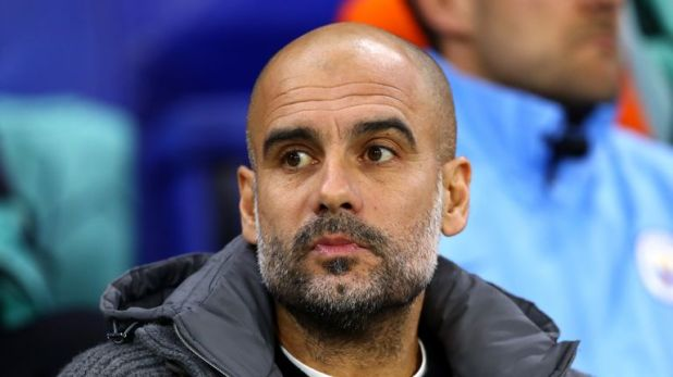 Guardiola looks on during City's sixth straight Premier League win