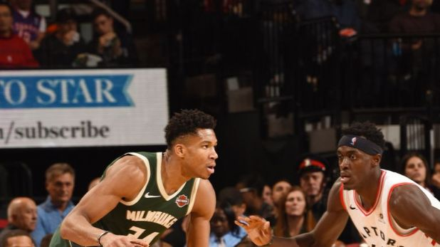 Giannis Antetokounmpo #34 of the Milwaukee Bucks dribbles the ball during the game against the Toronto Raptors on December 9, 2018 at the Scotiabank Arena in Toronto, Ontario, Canada.