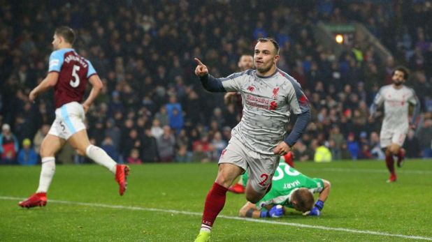 Xherdan Shaqiri celebrates scoring Liverpool's third goal against Burnley