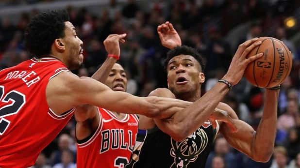 Giannis Antetokounmpo comes under pressure from the Bulls' defense