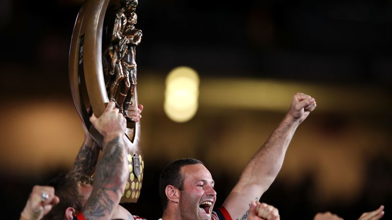 An elated Boyd Cordner holding the Provan-Summons Trophy