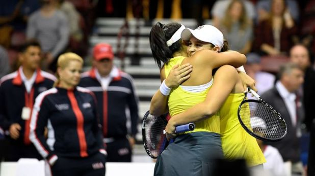 Priscilla Hon and Ashleigh Barty celebrate their doubles win over the USA
