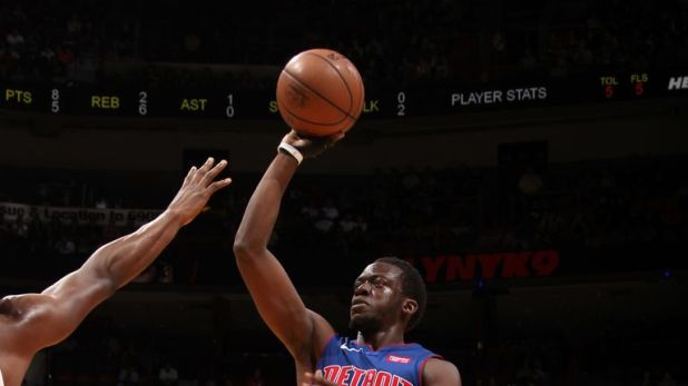 Reggie Jackson lofts a one-handed shot against the Heat