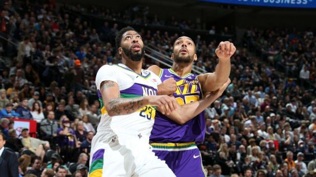 SALT LAKE CITY, UT - MARCH 4: Anthony Davis #23 of the New Orleans Pelicans and Rudy Gobert #27 of the Utah Jazz fight for the rebound on March 4, 2019 at vivint.SmartHome Arena in Salt Lake City, Utah. NOTE TO USER: User expressly acknowledges and agrees that, by downloading and or using this Photograph, User is consenting to the terms and conditions of the Getty Images License Agreement. Mandatory Copyright Notice: Copyright 2019 NBAE (Photo by Melissa Majchrzak/NBAE via Getty Images)