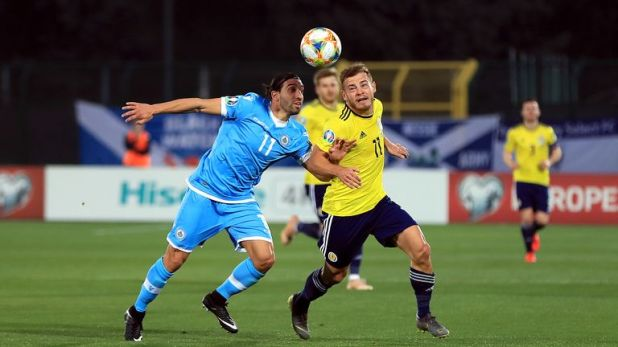 San Marino's Manuel Battistini (left) and Scotland's Ryan Fraser battle for the ball