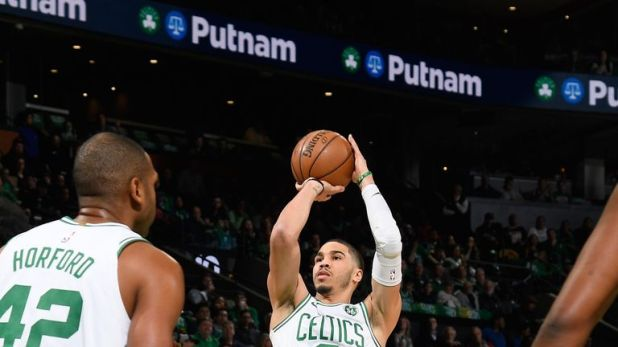 Jayson Tatum shoots a jump shot in Game 2 against the Pacers