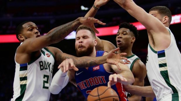 Blake Griffin is crowded out by a trio of Milwaukee Bucks defenders