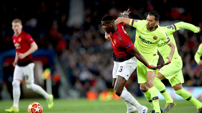Pogba and Sergio Busquets in action at Old Trafford