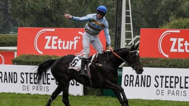 Davy Russell riding Carriacou to victory in the Grand Steeple-Chase de Paris