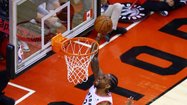 Kawhi Leonard #2 of the Toronto Raptors drives to the basket against the Milwaukee Bucks during overtime in game three of the NBA Eastern Conference Finals at Scotiabank Arena on May 19, 2019 in Toronto, Canada.