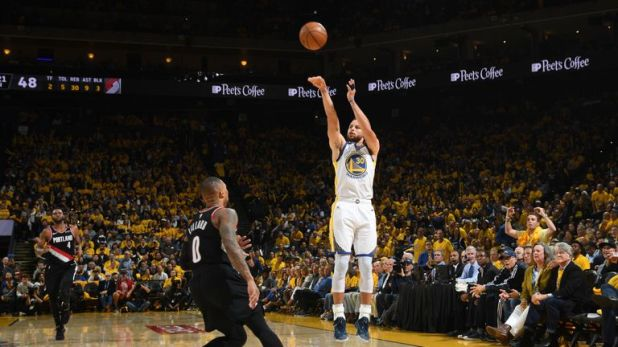 Stephen Curry fires a three-pointer in Game 1 of the Western Conference Finals