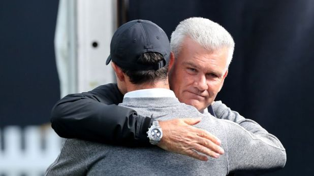 Rory McIlroy gives Tim Barter a hug after their interview