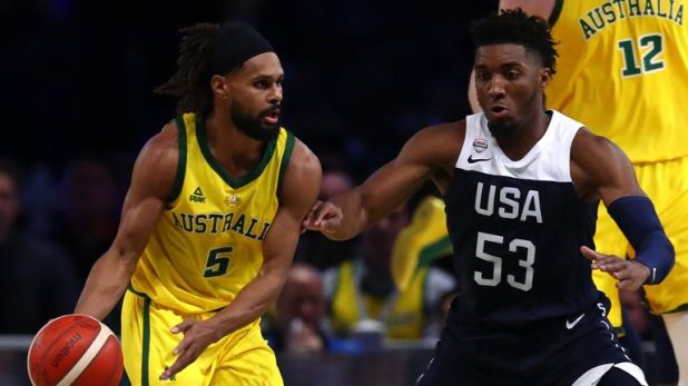 Patty Mills is guarded by Donovan MItchell