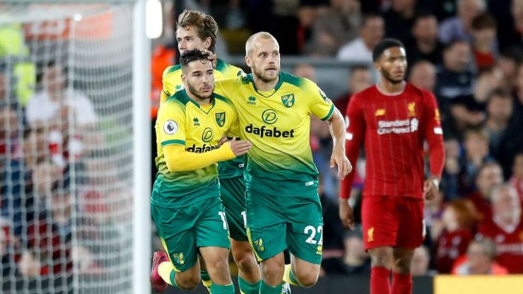 Teemu Pukki (right) celebrates scoring Norwich's goal