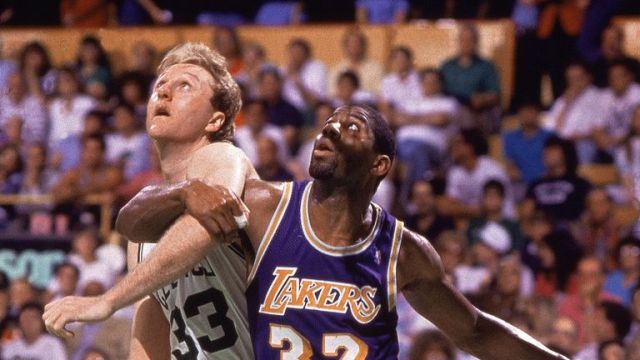 Larry Bird and Magic Johnson compete for a rebound in the 1987 NBA Finals