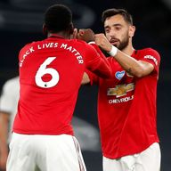 Paul Pogba celebrates with Bruno Fernandes
