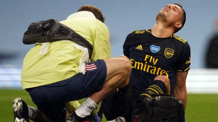 Granit Xhaka receives treatment before being taken to Manchester City