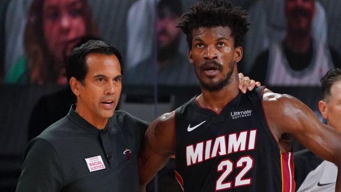 Heat coach Erik Spoelstra speaks with star man Jimmy Butler