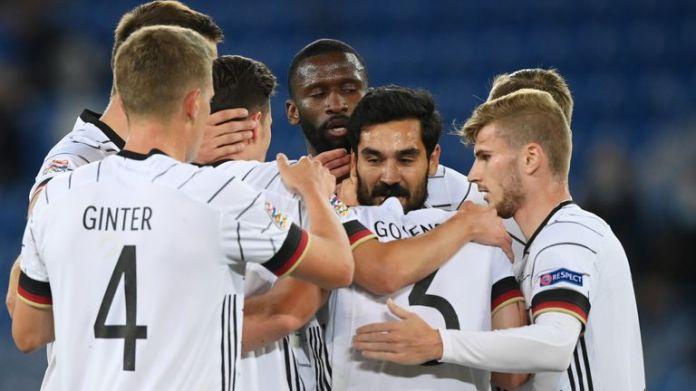 Ilkay Gundogan celebrates with his German teammates after his opening