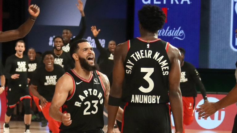 OG Anunoby is congratulated by team-mate Fred VanVleet after sinking a buzzer-beating three-pointer to win Game 3