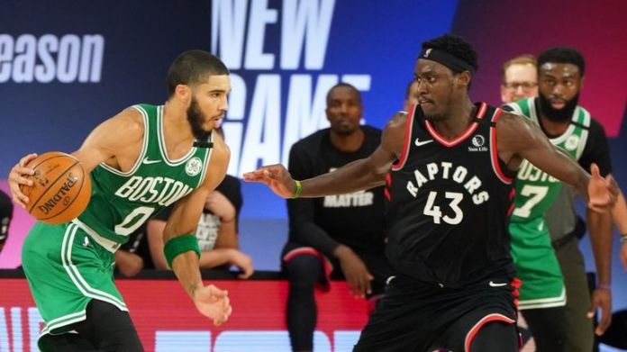 Boston Celtics' Jayson Tatum handles the ball against Toronto Raptors Pascal Siakam in Round 2, Game 6 of the Eastern Conference Semifinals