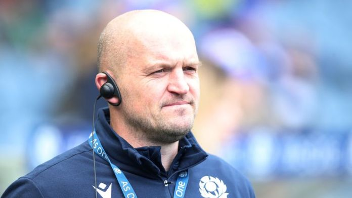 Head coach Gregor Townsend looks at the fall Nations Cup silverware for Scotland