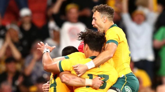 Australia celebrate scoring a try against the All Blacks
