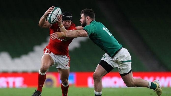 Leigh Halfpenny tries to get through the tackle of Robbie Henshaw