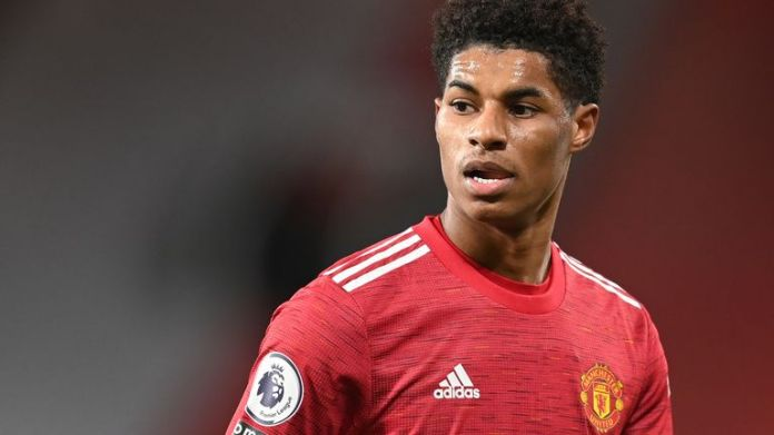 Marcus Rashford of Manchester United in action during the Premier League match between Manchester United and Manchester City at Old Trafford on December 12, 2020 in Manchester, England. The match will be played without fans, behind closed doors as a Covid-19 precaution. (Photo by Michael Regan/Getty Images)