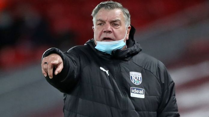 West Bromwich Albion's English Head Coach Sam Allardyce (L) and West Bromwich Albion's assistant head coach Sammy Lee (R) watch from the touchline during the English Premier League football match between Liverpool and West Bromwich Albion at Anfield in Liverpool, north west England on December 27, 2020. (Photo by Nick Potts / POOL / AFP)
