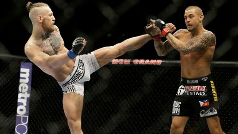 AP - Conor McGregor, left, kicks Dustin Poirier, during their fight, Saturday, Sept. 27, 2014, in Las Vegas. McGregor won via TKO.