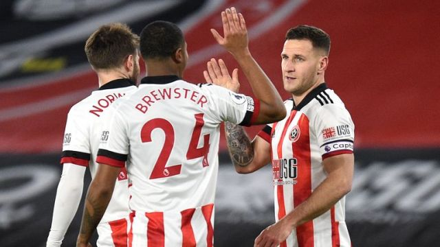 Billy Sharp celebrates his goal with Rhian Brewster and Oliver Norwood