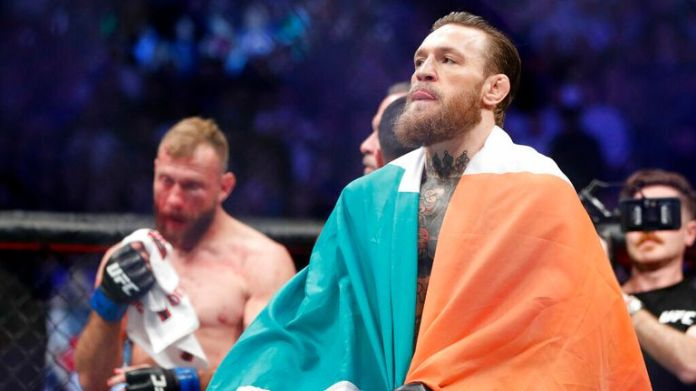"""AP - Conor McGregor celebrates after defeating Donald """"Cowboy"""" Cerrone during a UFC 246 welterweight mixed martial arts bout"""