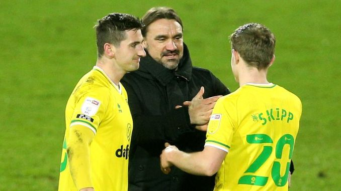 Norwich City manager Daniel Farke pictured with Oliver Skipp and Kenny McLean after the 1-0 win over Barnsley