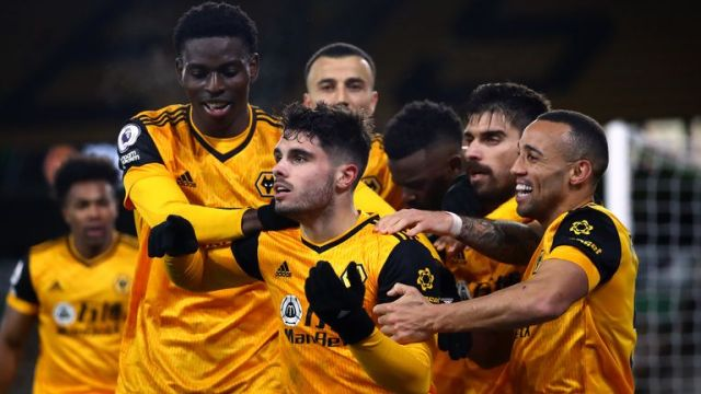 Pedro Neto is congratulated by his team-mates after his winner for Wolves against Chelsea