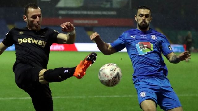 West Ham's Vladimir Coufal, left, duels for the ball with Stockport County's Jordan Williams