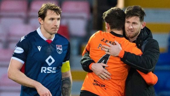 Dundee United's Dillon Powers and Calum Butcher celebrate the win, while Ross County's Callum Morris looks frustrated