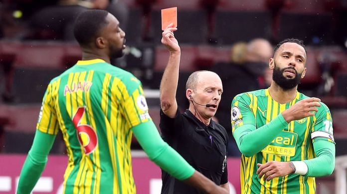 Mike Dean shows a red card to Semi Ajayi
