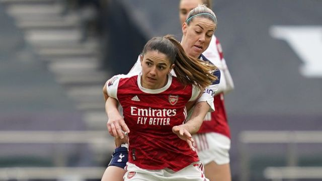 Arsenal's Danielle van de Donk (front) and Tottenham Hotspur's Alanna Kennedy battle for the ball