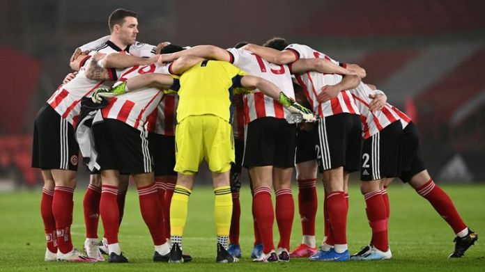 Sheffield United come together in a pre-match huddle at Bramall Lane