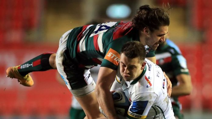 London Irish's Tom Parton looks to get past a diving tackle from Leicester Tigers' Kobus van Wyk