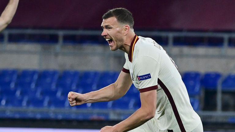 Edin Dzeko celebrates his equaliser on the night for Roma against Ajax