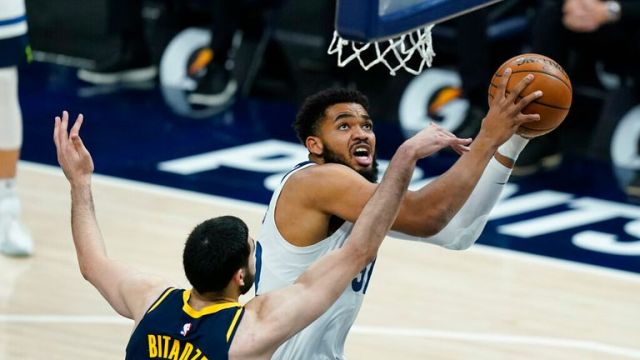 AP - Minnesota Timberwolves' Karl-Anthony Towns (32) is fouled by Indiana Pacers' Goga Bitadze (88)