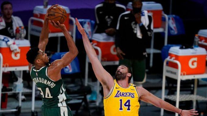 AP -  forward Giannis Antetokounmpo (34) takes a shot against Los Angeles Lakers center Marc Gasol (14)