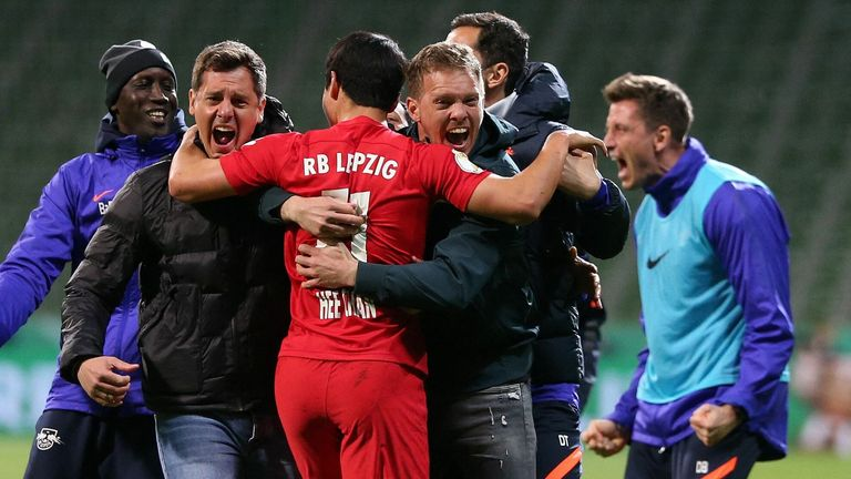 Julian Nagelsmann celebrates on the field after RB Leipz's dramatic extra-time victory over Werder Bremen